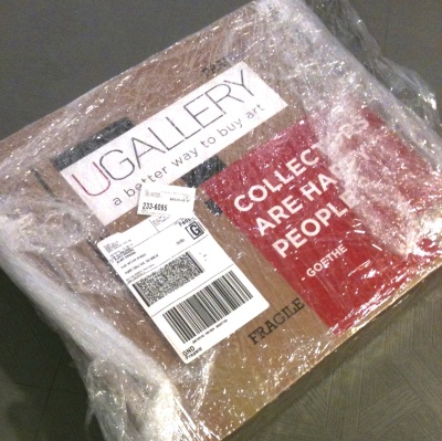 box that UGallery sends to me. I pop my work in the foam sandwich/cutout, stick on the prepaid label and drop it off at the UPS store. What a genius system!