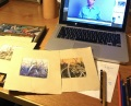 Desk area Ever the multi-tasker. Listening to a lecture by Daniel Ariely while reworking some monotypes with various media.