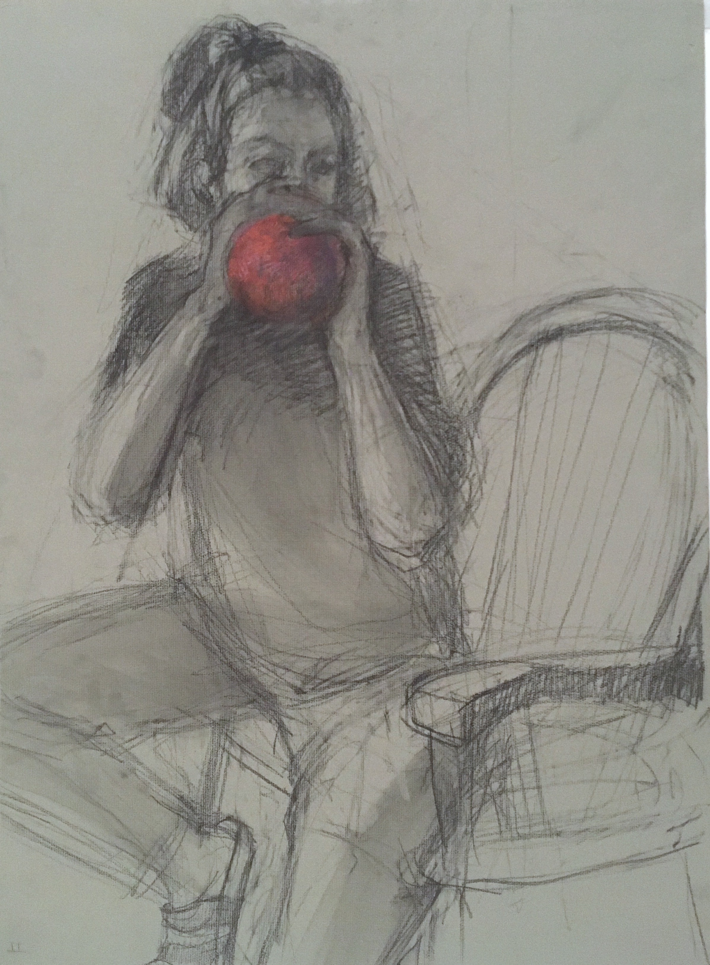 charcoal drawing of woman in chair blowing up a balloon