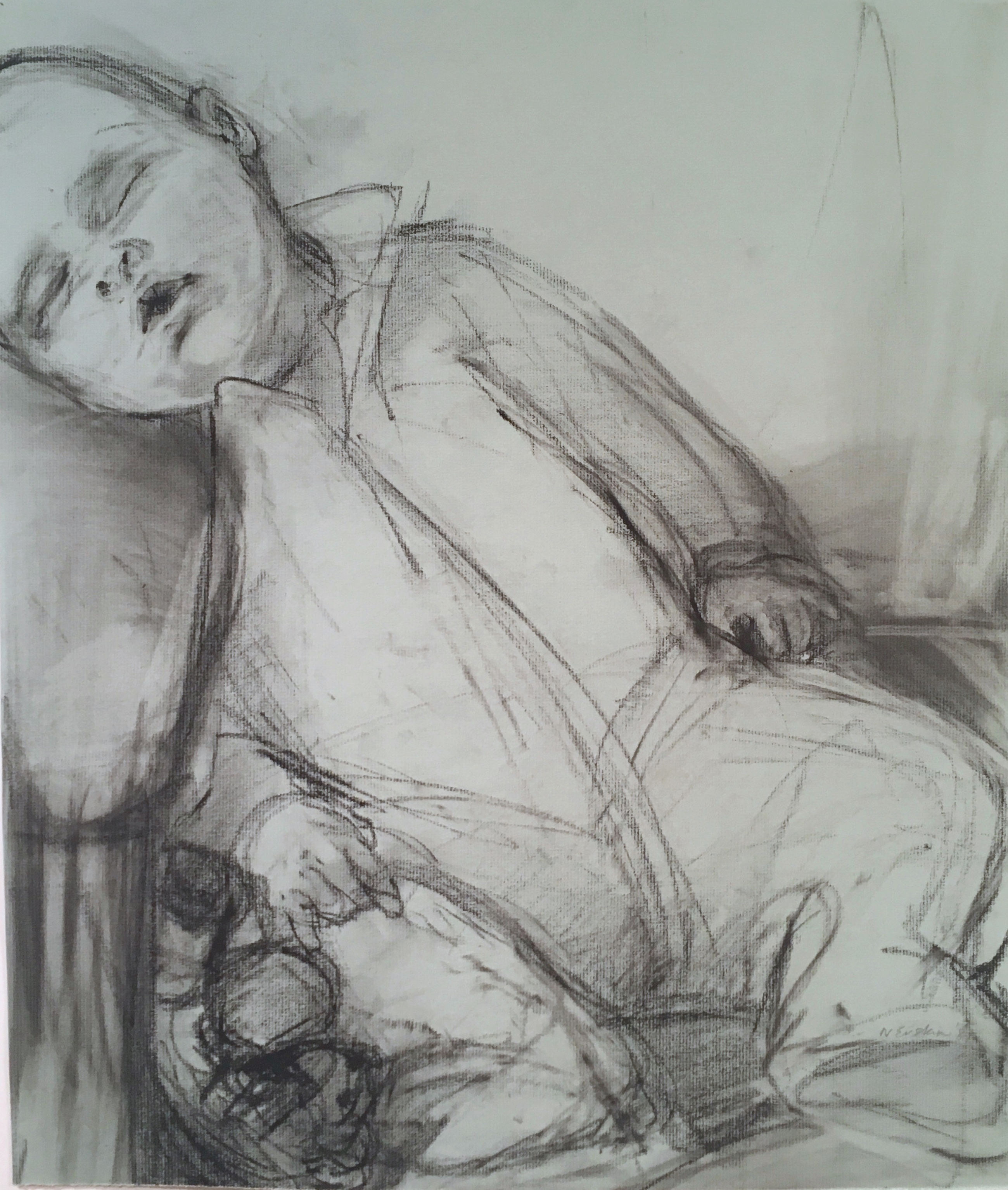 charcoal drawing on blue paper of sleeping leaning baby