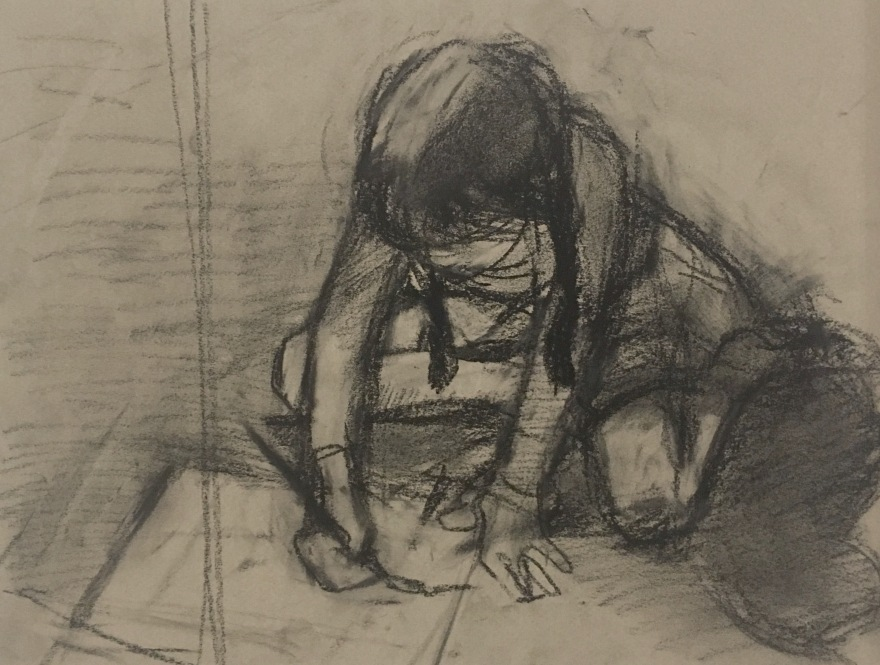charcoal drawing of girl drawing on the floor